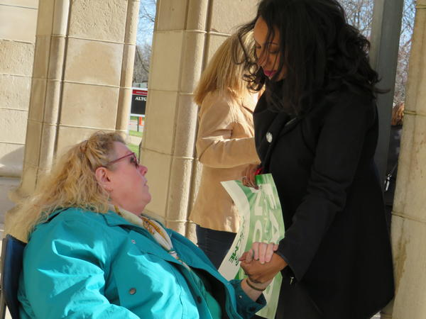 Illinois State Rep. Litesa Wallace (right) talks with a protestor during the AFSCME demonstration Monday afternoon.