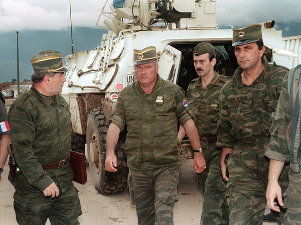 Ratko Mladic (center) arrives at Sarajevo airport on Aug. 10, 1993.