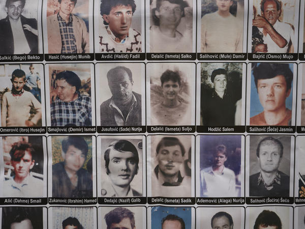 Photos of Bosnian Muslim victims are seen on a banner outside the International Criminal Tribunal for the former Yugoslavia in The Hague. The tribunal sentenced Ratko Mladic to life imprisonment for the war crimes and genocide he committed during the 1992-1995 Bosnia war.