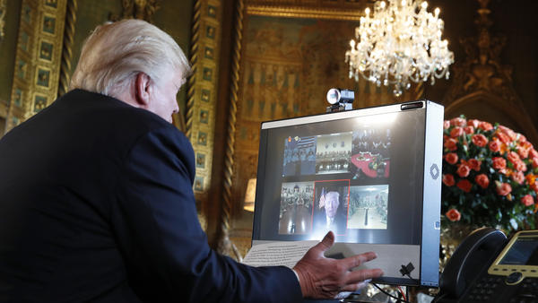 President Donald Trump speaks with members of the armed forces via video conference at his private club, Mar-a-Lago, on Thanksgiving, Thursday, Nov. 23, 2017, in Palm Beach, Fla.