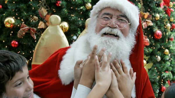 Children feel Santa's beard at a shopping mall in Santiago, Chile.