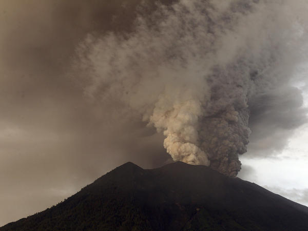 Clouds of ashes rise from the Mount Agung volcano erupting in Karangasem, Indonesia, on Monday.