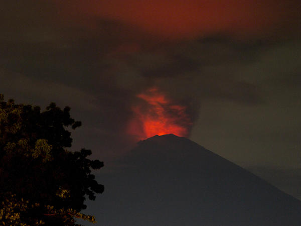 View of Mount Agung Volcano Erupted in the morning from Amed Beach. Mount Agung Volcano erupted, sending skyward a 3,000-meter cloud of ash.