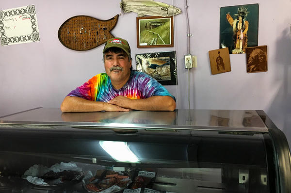 Paul Mattz Van Mechelen, who runs Paul's Famous Smoked Salmon, has had to buy salmon from fishermen hundreds of miles away instead of fishing for Chinook in the Klamath River, just 50 feet from his California shop.