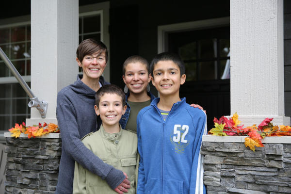 <p>Angie Chapin with her children, Asjia, Imani and Kaliq (left to right) in front of their Camas, Washington home. Mekhi is not pictured here.</p>
