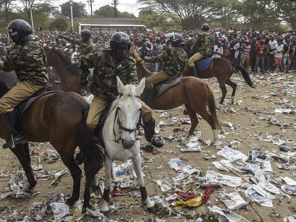 Mounted Kenyan Police intervene during a stampede outside the Kasarani stadium in Nairobi as supporters of Kenya's President try to get into the venue to attend his inauguration ceremony on Tuesday.