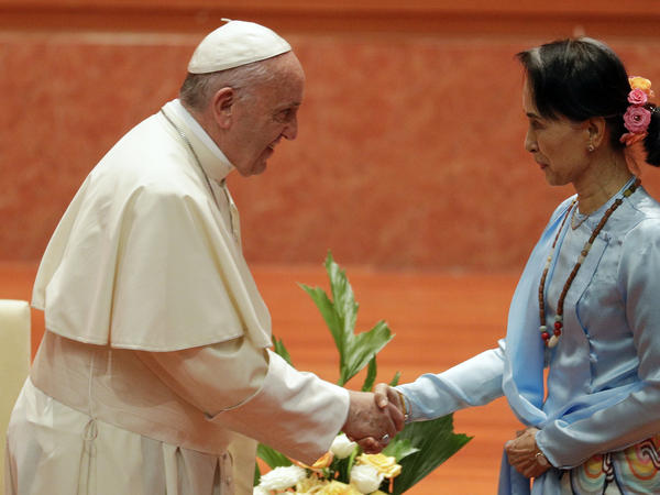 Pope Francis shakes hands with Myanmar's leader Aung San Suu Kyi as they meet at Naypyitaw's presidential palace in Myanmar on Tuesday.