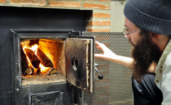 Jonathan Bethony bakes his whole grain breads in a wood-fired oven, heated to about 500 degrees, to help the weighty loaves rise.