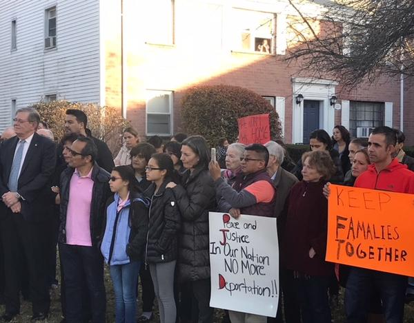 Martinez's husband, wearing a pink shirt, stands next to the couple's daughters in the crowd. Stamford Mayor David Martin stands to the right of the family.