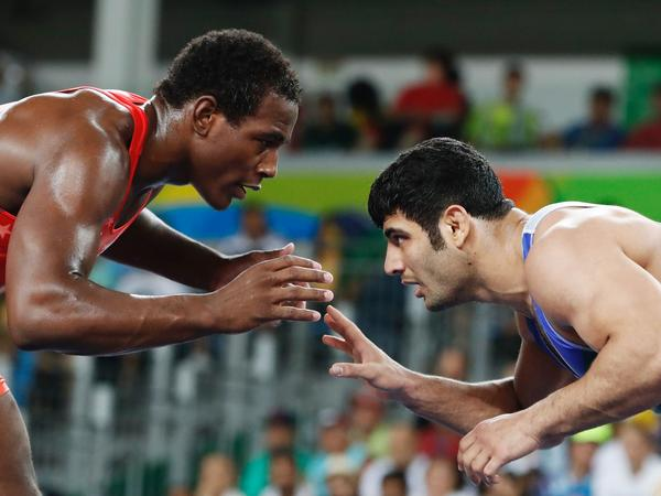 A photo from 2016 Rio Games, shows Iran's Ali Reza Karimi, right, facing off USA's J'den Michael Tbory Cox (red) in the men's 86kg freestyle quarter-final match.