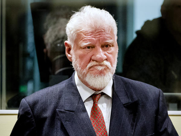 Slobodan Praljak enters the Yugoslav War Crimes Tribunal in The Hague, Netherlands, on Wednesday. The hearing was suspended after Praljak drank what he said was poison. He died hours later.