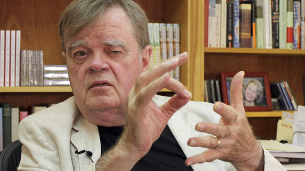 Garrison Keillor, creator and former host of <em>A Prairie Home Companion,</em> talks at his St. Paul, Minn., office in July. Minnesota Public Radio has announced it is cutting ties with Keillor and his production company owing to allegations of inappropriate behavior.