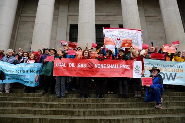 <p>Opponents of a proposed oil terminal in Vancouver, Washington, gather on the steps of the Capitol building in Olympia.</p>
