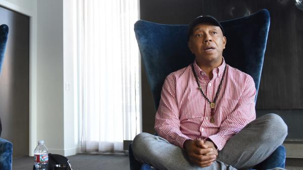 Russell Simmons, co-founder of the hip-hop label Def Jam, announced he would step down from the leadership of the businesses he founded.