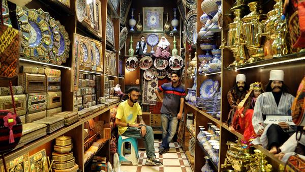 Iranian shopkeepers in the main bazaar in the capital, Tehran, in September. Iranians are eager for economic sanctions to be lifted and have been moving quickly to meet their obligations under a nuclear deal, according to analysts monitoring the agreement.