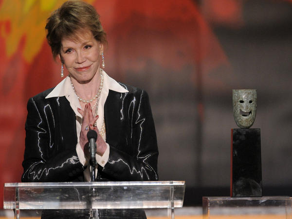 Moore accepts the Screen Actors Guild Life Achievement Award in 2012.