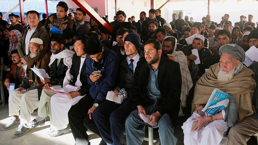 Afghans seeking passports wait in line in Kabul on Jan. 20. Many Afghans are seeking to leave the country, though some have returned from countries like Germany after finding out that they were unlikely to receive asylum.