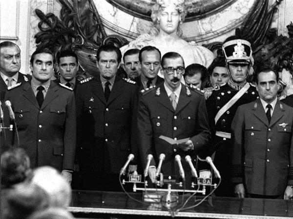 Gen. Jorge Rafael Videla (center) was sworn in as Argentina's president on March 24, 1976, after the overthrow of President Isabel Peron in a coup.