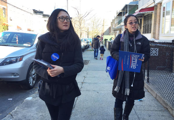 Shiman Shan (left) and Brenda Nguyen canvassed voters for the Bernie Sanders campaign in a New York City neighborhood with a growing Chinese-American community.