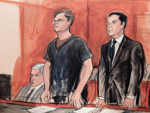 In this courtroom drawing, Russian banker Evgeny Buryakov (left) stands with attorney Scott Hershman during sentencing on espionage charges on May 25 in New York.