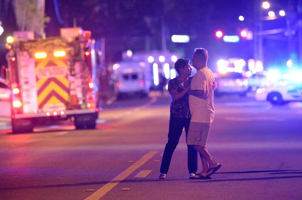 Family members wait near the Pulse nightclub in Orlando, Fla., on Sunday for word from police about what would turn out to be the deadliest mass shooting in modern U.S. history.