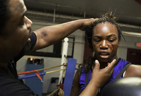 Jason Crutchfield, Claressa's coach, examines her after a sparring session at Berston Field House in Flint, Michigan. Claressa trained at Berston from age 11 to 17. When she was 13, and before it was announced that women would be allowed to box in the Olympics, Crutchfield predicted she would win the Olympic gold.