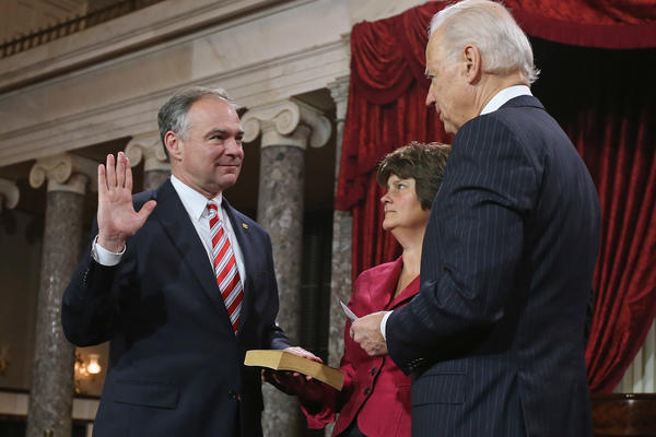 Sen. Tim Kaine participates in a swearing-in with his wife Anne Holton and Vice President Joe Biden in the Capitol on Jan. 3, 2013 in Washington, D.C.