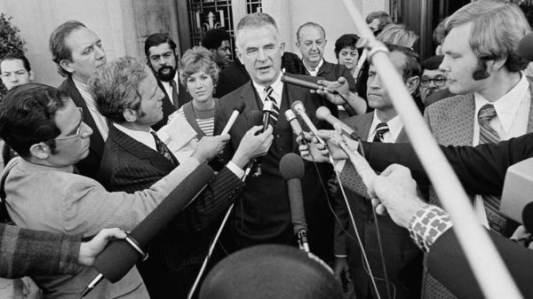 Special Watergate prosecutor Archibald Cox talks to media outside the U.S. District Court in Washington in 1973 after ousted White House counsel John W. Dean III pleaded guilty to conspiring to obstruct the Watergate investigation. President Nixon fired Cox the day after this press conference.