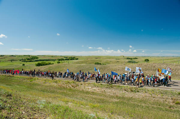 Native American protesters march from an encampment on the banks of the Cannonball River to a nearby construction site for the Dakota Access Pipeline to perform a daily prayer ceremony.