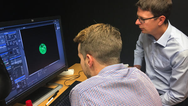 Fredrik Lanner (right) of the Karolinska Institute in Stockholm and his student Alvaro Plaza Reyes examine a magnified image of an human embryo that they used to attempt to create genetically modified healthy human embryos.