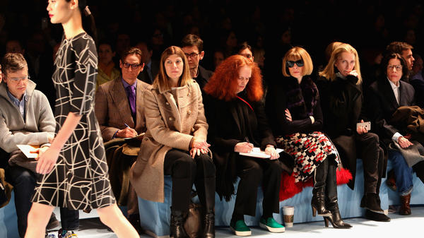 Coddington sits beside American <em>Vogue</em> Editor-in-Chief Anna Wintour at a 2015 fashion show. Instead of taking notes, Coddington says she prefers to sketch the dresses she sees on the catwalk.