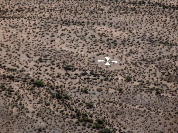 "Pez Owen was joyriding in her Cessna airplane when she first spotted a giant X etched in the desert. ""It's not on the [flight] chart. There just wasn't any indication of this huge cross,"" she says."