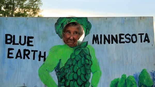 Norma Bauerschmidt poses with the Jolly Green Giant in Blue Earth, Minn., near the beginning of her journey in August 2015.