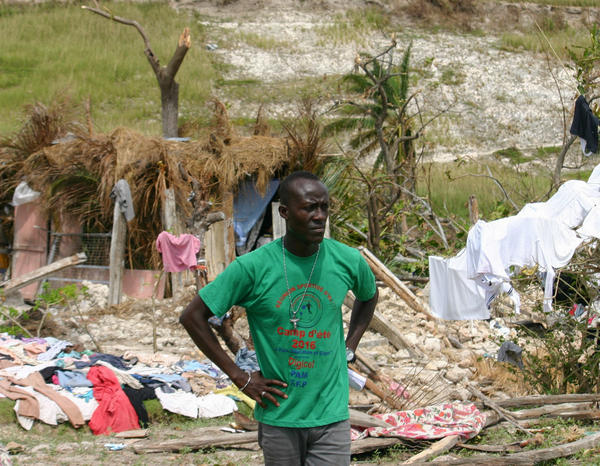 Emmanuello Charlien, a volunteer, assesses hurricane damage in Port Salut.