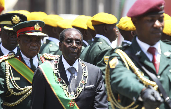 Zimbabwe's President Robert Mugabe inspects the guard of honor at Parliament on Oct. 6. During his 36-year rule, the country has endured multiple economic crises, which the government blames on Western sanctions.