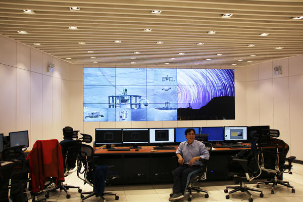 Lead scientist Zhu Ming sits in the telescope's control center. Clusters of supercomputers process millions of gigabytes of data each day, representing the radio traffic of the universe that is picked up by the telescope.