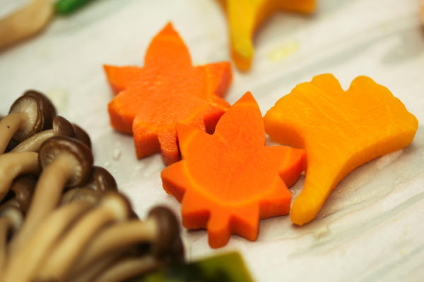 Carrots and pumpkin in the shape of leaves.