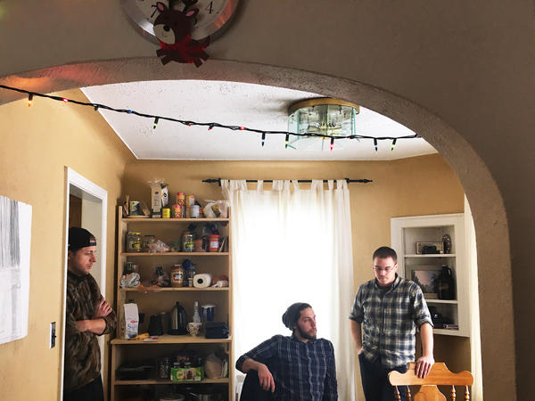 Mohammed Refaai's roommates, Johnny Zellers (left), Andrew Trumbull and Doug Walton, share a house in Toledo, Ohio.