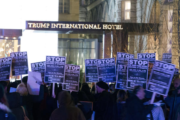 Demonstrators protest outside the Trump International Hotel in Washington, D.C., on Jan. 15.