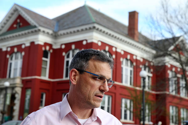 Mayor Chris Louras, standing outside City Hall in Rutland, says Syrian refugees will be a boost for the aging town, just as immigrants from southern and eastern Europe boosted Rutland's fortunes a century ago.