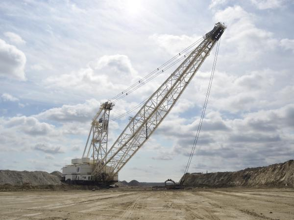 A dragline at the Center Mine in North Dakota removes dirt to expose layers of lignite coal. The coal is mined and transported to a power plant just a few miles away, where it's burned to generate electricity.