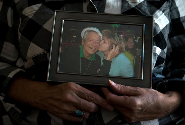 Ellen Bethea holds a picture of herself and her late husband, Archie.