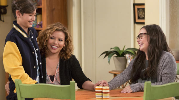 In Netflix's <em>One Day at a Time</em>, Justina Machado (center) plays a military veteran who is raising her two kids (Marcel Ruiz, left, and Isabella Gomez) without their father<em>.</em>