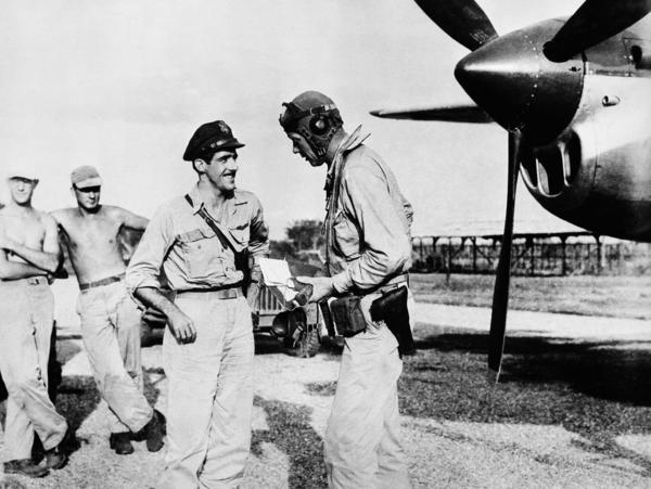 Lindbergh (right) at a U.S. military base in the Pacific in 1945. He flew more than 50 combat missions in the Pacific during World War II.
