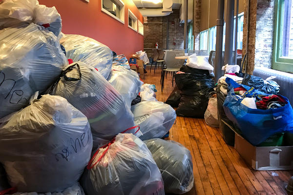 Plastic bags filled with clothing donations pile up in the hallways of the Nationalities Service Center, which has seen an uptick in donations for refugees and other immigrants since Trump's election.
