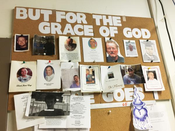 A bulletin board in the detox unit at Recovery Point of Huntington, W.Va., a residential drug and alcohol treatment facility, is covered with photos of former residents who died of their addictions.