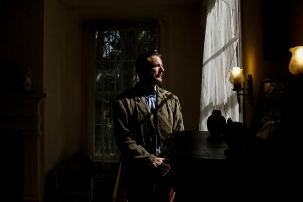 William Griffith, curator of Rowan Oak, poses for a portrait in an upstairs bedroom.