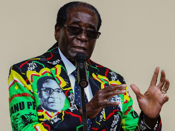 "Zimbabwe's President Robert Mugabe, who turns 93 on Tuesday, speaks at his party's annual conference in December, where he was endorsed as a candidate for the 2018 election. His wife said last week that even if he dies before the election, he should run ""as a corpse."""