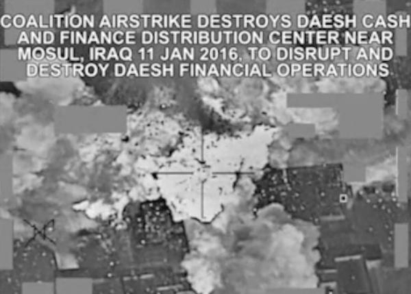 An airstrike targeting an Islamic State group cash and finance distribution center near Mosul, Iraq, as shown in a video released by the U.S. military.