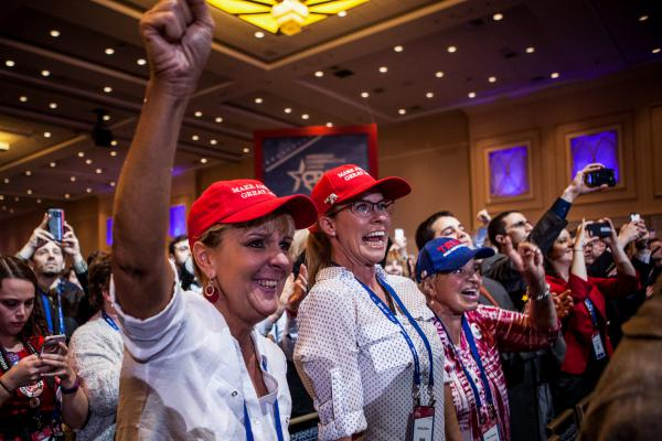 CPAC attendees cheer as President Trump speaks on the last morning of the conference.
